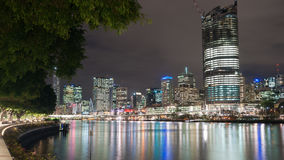 Brisbane city skyline lights across river at night from South Ba Royalty Free Stock Image