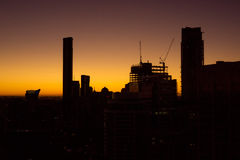 Brisbane city skyline at sunrise. Brisbane skyline at dawn, buildings in silhouette Stock Images