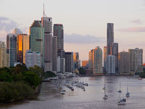 Brisbane City skyline at sunset. From Kangaroo Point Cliffs, showing orange reflections from the setting sun Stock Photography