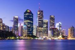 Brisbane city skyline. View of Brisbane city skyline with illuminated modern buildings and Brisbane river at twilight Royalty Free Stock Photography