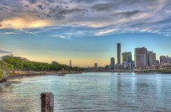 Brisbane City and Southbank Queensland Australia. Waterview sunset scene of Brisbane City and the Southbank Parklands composed into one shot (Queensland Stock Photo