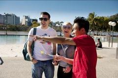 Brisbane Greeter helps tourist stock photography