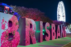 BRISBANE, QUEENSLAND, AUSTRALIA - AUGUST 19th 2018: View of the Brisbane sign and wheel at Southank, Brisbane city. Royalty Free Stock Images