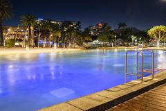 BRISBANE, QUEENSLAND, AUSTRALIA - AUGUST 19th 2018: View of the public pool at Southank, Brisbane city, Queensland at night. Stock Photos