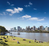 Brisbane sky line from the park and people in lawn,queens land,Australia. Eastphoto, tukuchina,  Brisbane sky line from the park and people in lawn,queens land Royalty Free Stock Photography