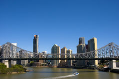 Brisbane Skyline. An image of the Brisbane Australia Skyline with the Storey Bridge and a ferry in the foreground stock photos