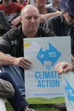 BRISBANE World Enviroment Day. BRISBANE, AUSTRALIA - JUNE 6 : man with say Yes to climate action sign listening to rally speakers during World Enviroment Day say stock photography