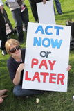 BRISBANE World Enviroment Day. BRISBANE, AUSTRALIA - JUNE 6 : Woman with act now or pay later anti polution sign at say Yes to carbon tax World Enviroment Day stock images