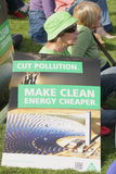 BRISBANE World Enviroment Day. BRISBANE, AUSTRALIA - JUNE 6 : Woman with anti polution clean energy sign at say Yes to carbon tax World Enviroment Day protest 6 royalty free stock photo