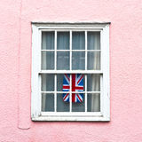 Union jack. Brish flag hanging in a window in a Suffolk cottage Royalty Free Stock Images