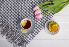 A brisk morning Black tea with lemon and cake on a beautiful bac Royalty Free Stock Images