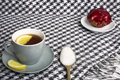 A brisk morning Black tea with lemon and cake on a beautiful bac Royalty Free Stock Photography