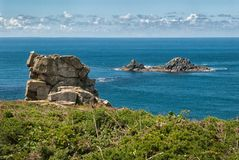 Brisons at Cape Cornwall Cornwall United Kingdom. The Brisons (Cornish: An Gribow, meaning the reefs) is a twin-peaked islet in the Atlantic situated 1 mile (1.6 Royalty Free Stock Photo