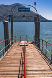 Brissago pier in Switzerland, waiting for a ferry boat to arrive Stock Photography