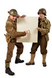 Bristish and american soldier show a poster. On the white background royalty free stock photo