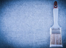 Bristle brush on metallic surface copy space construction concep Stock Image