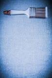 Bristle paintbrush on scratched metallic background copyspace co Stock Photos