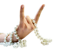 Bristling fingers with beads. Isolated hand with bristling fingers and white beads stock photos
