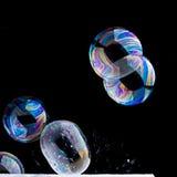 Bristning av såpbubblor fotografering för bildbyråer