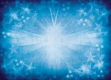 Bristningsbakgrund för blå stjärna. Arkivfoton
