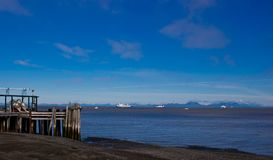 Bristol Bay on a nice day. Blue water and blue sky at the start of Salmon season. Dock at low tide stock images