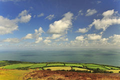 The Bristol channel from Porlock, Devon. This image shows the mighty expanse of the Bristol channel, seen here from Porlock in Devon. The horizon land in the stock photo
