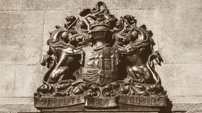 Bristol Coat of Arms in Sepia. English Crest of Bristol, Vintage Wall Ironwork, sepia tone horizontal photography Royalty Free Stock Image
