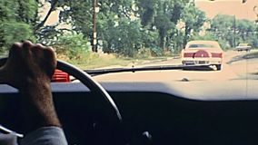Bristol County streets. Bristol County, Massachusetts, United States of America - circa 1970: point of view driving vintage car in Bristol County. Vintage cars stock footage