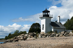 Bristol Ferry Lighthouse. Lies under the Mount Hope bridge in Bristol in Rhode Island. It is famous for being too close to the water table and always is flooded Royalty Free Stock Images