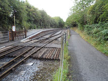 Bristol to Bath Railway Path Crossing. Railway track crossing beside the old train station platform, with the cycle path running alongside. Part of the 13 mile Royalty Free Stock Image