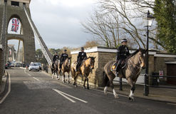 BRISTOL, UK - DEC 18: Mounted police crossing the Cifton suspension bridge on Dec 18 2014 in Bristol, UK Royalty Free Stock Image