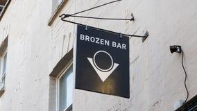 Bristol, UK - February 12 2020: Brozen Bar sign on St Nicholas Street. Brozen is a cocktail bar specialising in cocktails