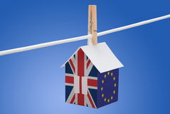 Britain, britain and EU flag on paper house. Concept - UK, Britain and EU flag painted on a paper house hanging on a rope Royalty Free Stock Photo