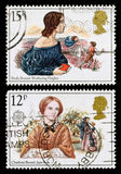 Britain Bronte Sisters Postage Stamps. Pair of used postage stamps printed in Britain celebrating Famous Authoresses, showing Emily Bronte and Wuthering Heights Royalty Free Stock Images