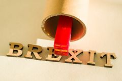 Brexit word abstract in vintage letters, background double decker bus toy model, tunnel. Britain exit from European Union, Brexit word abstract in vintage Stock Image