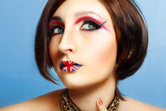 Britain flag on her lips. Closeup of girl with art make up britain flag on her lips and nails Stock Photos