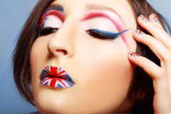Britain flag on her lips. Closeup of girl with art make up britain flag on her lips and nails Royalty Free Stock Images