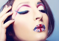 Britain flag on her lips. Closeup of girl with art make up britain flag on her lips and nails Royalty Free Stock Photos