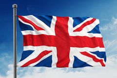 Britain flag. Waving on the blue sky background Royalty Free Stock Photos