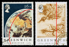 Britain Greenwich Meridian Postage Stamps. Pair of used postage stamps printed in Britain celebrating the Centenary of the Greenwich Merdian Time Line, circa Stock Photography