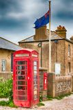 Only in Britain. HDR of Red Telephone box, post box and the Union flag Royalty Free Stock Photo