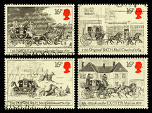 Britain Mail Coach Postage Stamps. Set of used postage stamps printed in Britain celebrating the Bicentenary of the First Mail Coach Run showing various Mail Royalty Free Stock Images