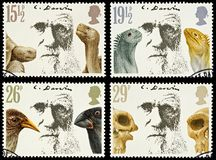 Britain Postage Stamps Charles Darwin. Set of British Used Postage Stamps Showing Charles Darwin and his Theory of Evolution, circa 1981 Royalty Free Stock Photo