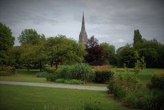 Britain& x27;s tallest church tower. View from the park in Salisbury with the church tower in the background Royalty Free Stock Images