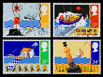 Britain Safety at Sea Postage Stamps. Set of used postage stamps printed in Britain for Safety at Sea showing Beachy Head Lighthouse, Lifeboat Launching Royalty Free Stock Images