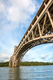 Britannia bridge over Menai Strait in North Wales. View of Britannia bridge across Menai Strait between island of Anglesey and mainland of Wales. Copy space in Stock Photo