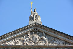 Britannia statue and Trident with Coat of arms bel Stock Image