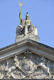 Britannia statue and Trident with Coat of arms below Royalty Free Stock Images