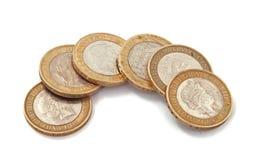 Britannici, Regno Unito, due monete di libbra Immagini Stock