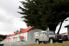 Brithis car in front of typical british town houses in Port Stanley, Falkland Islands Royalty Free Stock Image